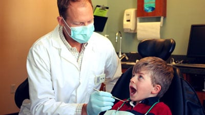 Dr. Jason Raynor with young patient