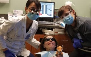 A patient receiving treatment from Dr. Stephanie Raynor during Free Dental Day.
